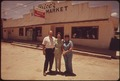 FAMILY IN FRONT OF THE GROCERY STORE THEY OWN IN LEAKEY TEXAS, NEAR SAN ANTONIO - NARA - 554868.tif