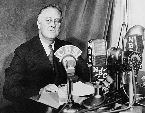 "President Franklin Roosevelt broadcast a series of ""fireside chats"" to directly speak to the public (September 30, 1934) FDR-September-30-1934.jpg"