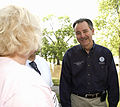FEMA - 35639 - FEMA Administrator Paulison speaks with an Iowa Resident.jpg