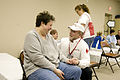 FEMA - 40028 - Red Cross manager comforts a resident in Kentucky.jpg