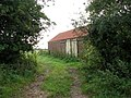 Farm track past barn - geograph.org.uk - 578069.jpg