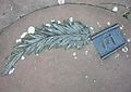 First monument of the Warsaw Ghetto palm tree leaf.JPG