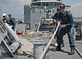 Flickr - Official U.S. Navy Imagery - Sailors heave on a mooring line as their ship leaves the pier..jpg