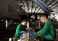 Flickr - Official U.S. Navy Imagery - Sailors wipe down an ALQ 99 jamming pod..jpg