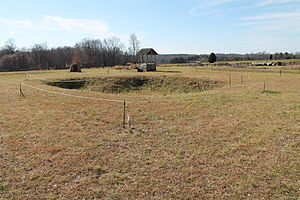 "Fort Dobbs (North Carolina) - The Fort Dobbs site, facing Fort Dobbs Road; note the ""cellar"", meaning the depression in the center of the site"