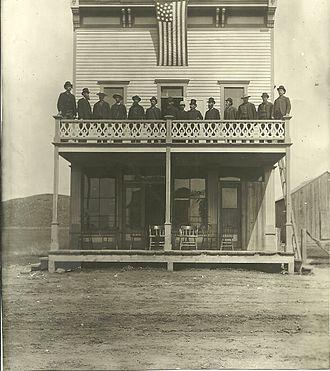 Minnesela, South Dakota - The founders of Minnesela standing on the balcony of the Minnesela Hotel in 1889.