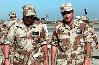 Unified Task Force - US President George H. W. Bush (left) visiting Somalia to witness first hand the efforts of Task Force Somalia that was in direct support of Operation Restore Hope. On the right is Brigadier General Thomas Mikolajcik.