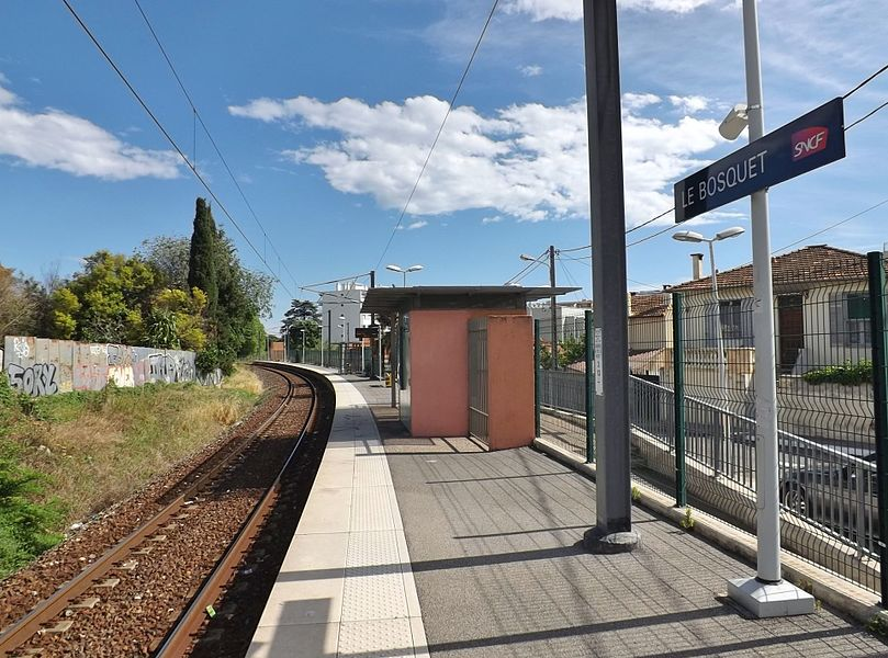 Sight of a single platform and track of the Cannes - Le Bosquet railway station, in Cannes, Alpes-Maritimes, France.