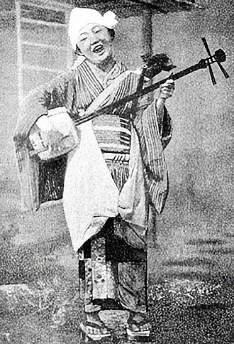 Music of Japan - A Japanese folkswoman with her shamisen, 1904
