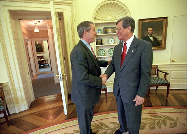 George W. Bush in the Oval Office 2001 west door opened