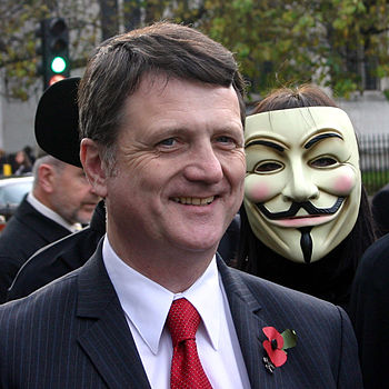 English: Gerard Batten MEP poses with proteste...