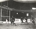 Glenn Campbell (no helmet) races for a Giants score vs Yellow Jackets at Polo Grounds 1929.jpg
