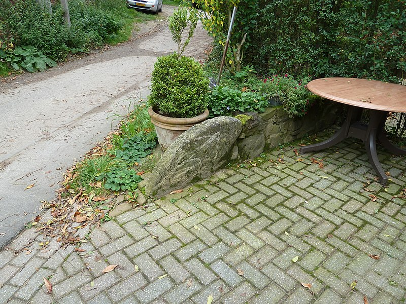 """Millstone of the watermill """"Molen op de Meulenberg"""" in 's-Gravenvoeren, Belgium"""