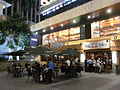 HK Wan Chai 合和中心 Hopewell Centre night sidewalk cafe bar Queen's Road East.jpg