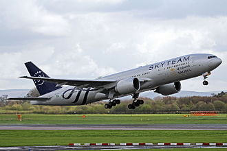 SkyTeam - A Saudia Boeing 777-200ER taking off at Manchester Airport wearing the SkyTeam livery