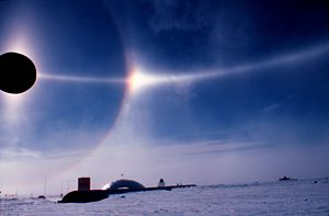 Parhelic circle - A crisp parhelic circle (horizontal line) over South Pole Station. Photo: John Bortniak, NOAA, January 1979.