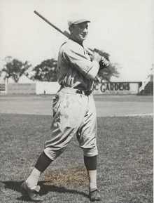 Harry Rosenberg with a baseball bat in a baseball uniform