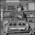 Heart Mountain Relocation Center, Heart Mountain, Wyoming. A young mechanic of Japanese ancestry, a . . . - NARA - 539241.tif