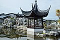 Heart of the Lake Pavilion and rock mountain in Dunedin Chinese Garden.jpg