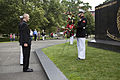 Honorary Marine Daran Wankum, left, participates in a wreath laying ceremony at the Marine Corps War Memorial in Arlington, Va, June 13, 2013 130613-M-KS211-004.jpg