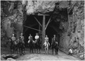 Horseback party at west entrance to Zion Tunnel. This tunnel will shorten the distance from Zion to Bryce by 70... - NARA - 520397.tif