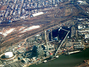 Hudson Generating Station - Aerial view of the Hudson Generating Station with coal-delivery barges in the foreground