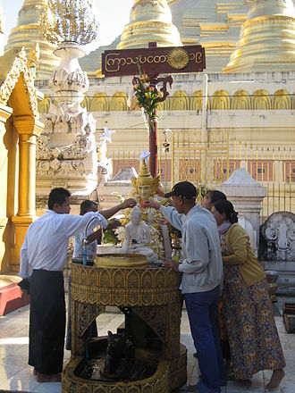 Burmese zodiac - The Jupiter planetary post at the Shwedagon Pagoda, with the representative vehicle of the rat underneath
