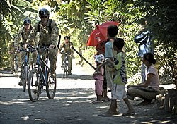 ISF soldiers on bike patrol.jpg