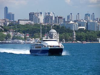 Levent - A catamaran Seabus on the Bosphorus, with the skyline of Levent in the background. Istanbul Sapphire is the first tower at left.