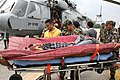 Injured rescued people are being de-boarded from an IAF Mi-17 helicopter for emergency medical treatment in the quake-hit Nepal.jpg