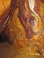 Iron-oxide stained limestone cave wall (Ohio Caverns, western Ohio, USA) 7 (30590906180).jpg