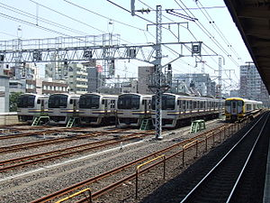 Kinshichō Station - JR Sōbu Line trains stabled next to the station platforms during the daytime, August 2007