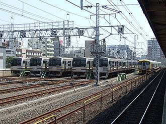 Kinshichō Station - JR Sōbu Line trains stabled next to the station platforms during the daytime, August 2007