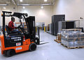 James Hollyfield, with the 50th Logistics Readiness Flight, uses a forklift to move a cargo pallet at the secure area logistics facility at Schriever Air Force Base, Colo 130115-F-OT300-339.jpg
