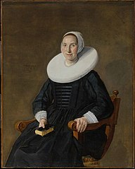 Portrait of a seated woman with a book