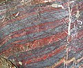 Jaspilite banded iron formation (Soudan Iron-Formation, Neoarchean, ~2.69 Ga; Stuntz Bay Road outcrop, Soudan Underground State Park, Soudan, Minnesota, USA) 8 (19038889029).jpg
