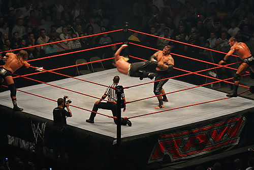 A tag team match in progress: Jeff Hardy kicks Umaga, while their respective partners, Triple H and Randy Orton, encourage them and reach for the tags Jeff-Hardy-Dropkick,-RLA-Melb-10.11.2007 filtered.jpg