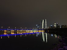 Jinji Lake Bridge, Gate to the East, and Suzhou Center.jpg