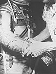 John H. Glenn Jr. being fitted with gloves for his space suit (5134456105).jpg