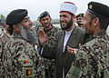 Jordanian Armed Forces 2nd Lt. Fawaz Salem Alqudah, center, a Muslim scholar serving with a Jordanian Engagement Team, speaks with soldiers assigned to the Afghan National Army's 201st Corps at Forward 130424-A-UO630-009.jpg