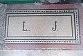 Kakucsi Liebner József császári és királyi asztalnok monogramja a palota bejáratánál, 2018 Józsefváros.jpg