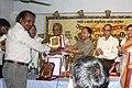 Khondakar Ashraf Hossain receiving honorary crest at 18th years celebration of Somujjol Subatas (01).jpg