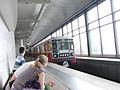 Krasnaya strela (Red arrow) train at Vorobyovy Gory station (Метропоезд Красная стрела на станции Воробьёвы Горы) (4611530383).jpg