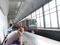 Krasnaya strela (Red arrow) train at Vorobyovy Gory station (Метропоезд Красная стрела на станции Воробьёвы Горы) (4611530383)