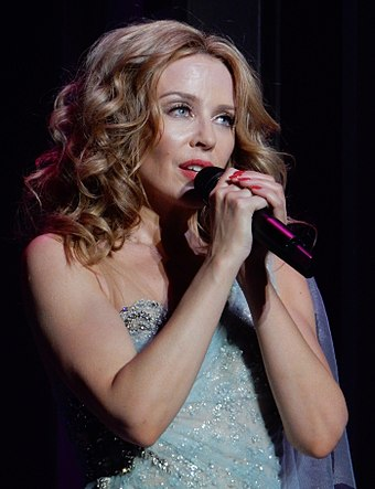 2004 winner, Kylie Minogue. Kylie Minogue - Kiss Me Once Tour - Manchester - 26.09.14. - 154 (15210678760) (cropped).jpg