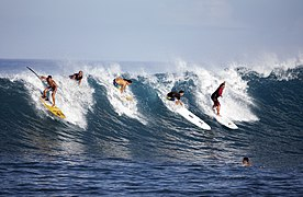 La horde - Surfers riding a wave in Paea, Tahiti.jpg