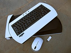 White wireless keyboard, with thumb drive and wireless mouse