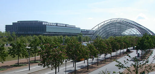 The western wings and central hall of the new Leipziger Messe Fairgrounds. The east wings and business centre are off-camera to the right. The central hall alone has been described as being large enough to enclose a World Cup football pitch. Leipzig Neue Messe.jpg