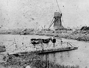 Little Thetford - Chain ferry at Little Thetford c. 1905. Harrimere windmill is seen on the Barway side of the River Great Ouse