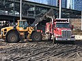 Loading spoils from the foundation excavation of the LIRR employee access bridge. (CQ033, 2-13-2018) (26414190318).jpg